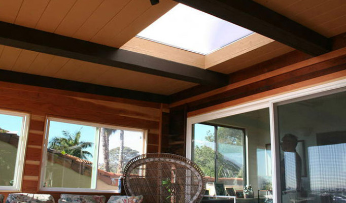Skylight viewed from under custom wood deck covering with redwood walls & windows in Point Loma