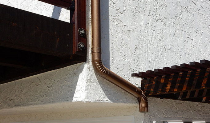 Copper rain gutter down spout