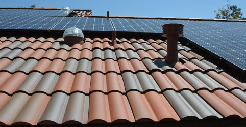Close up of US tile Claymax, a low profile clay tile, solar tubes and solar system