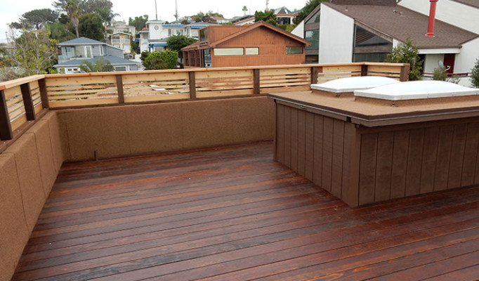Rooftop stained wood deck with custom stairwell/hatch cover and skylights in Ocean Beach