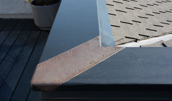 Custom copper mitre flashing on a custom rooftop deck