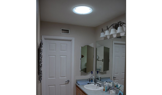 Solar tube skylght in a landlocked (no windows) bathroom lights up the entire room