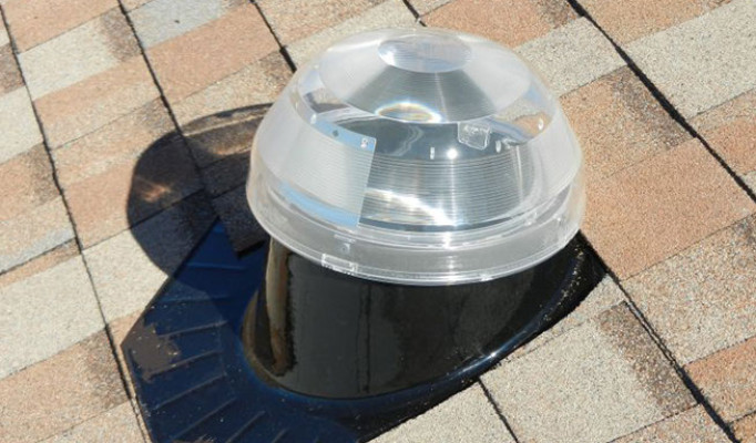 The top of a 10″ solar tube light