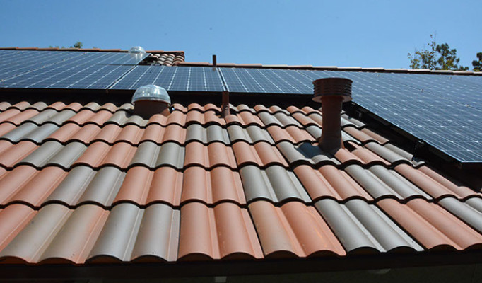 Close up of US tile Claymax, a low profile clay tile, solar tubes and solar system.
