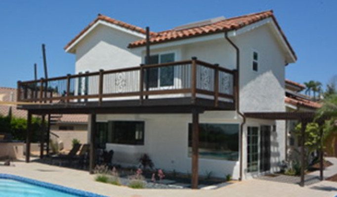 Clay tile roof, copper gutters, custom deck & railing with solar system and lattice patio