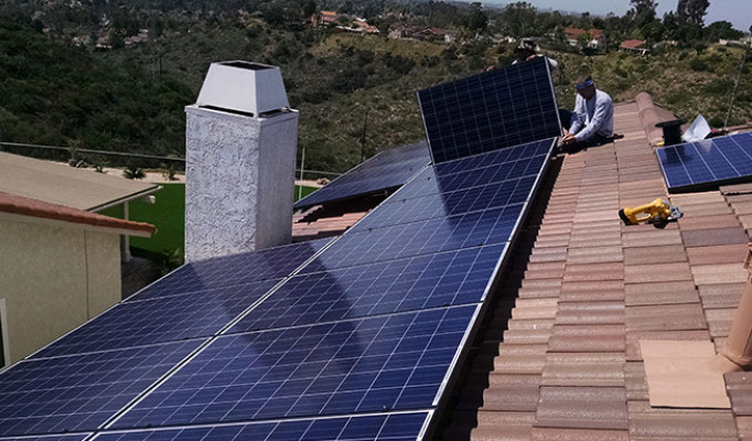Solar system being installed on an Eagle Malibu low profile tile in Tierra Santa