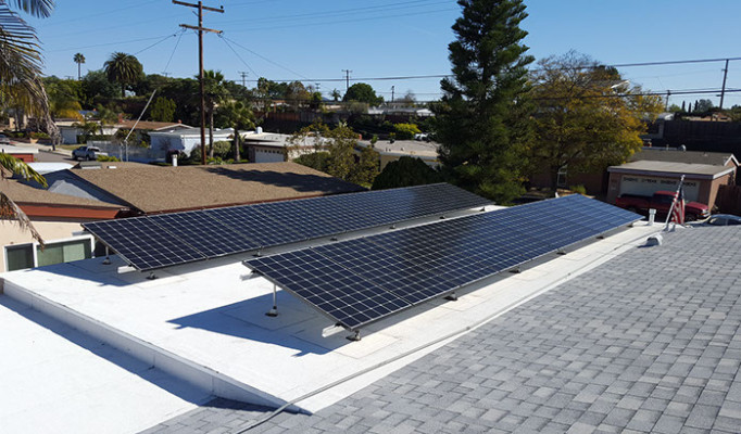 Title 24 compliant cool roof (gray shingles) & cool flat roof (white) with tilt up solar system in San Diego