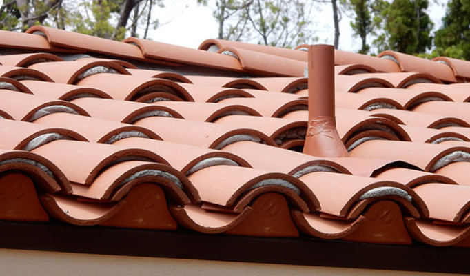 Pipe flashing in a custom 2-piece tile roof