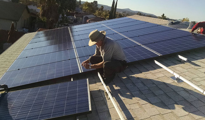 Cool roof (reflects light to keep home cooler) and custom solar system install in San Diego