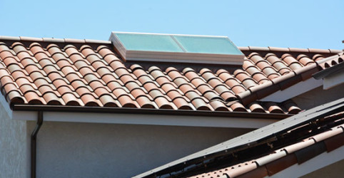 Custom skylight with solar panels in the foreground